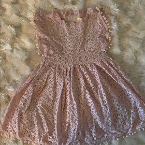Other - New. Never worn. Lace dress with Pom Pom detail.